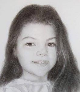 retrato al carboncillo de la niña